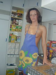 Naked housewife posing for hubby in the kitchen