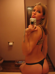 Horny hottie playing with herself on the washbasin