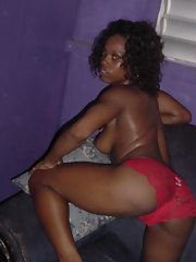 Curly-haired naked black chick posing for the camera