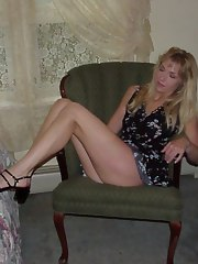 Blonde MILF does a striptease inside her room