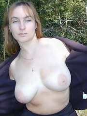 Soaked MILF babe nude and posing outdoors