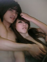 Oriental pair takes naughty selfpics in bed and in the bathroom
