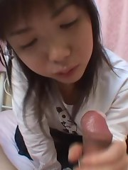 POV of a cute Asian babe with huge eyes engulfing cock