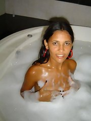 A sexy Latina chick gets naked in the bathtub