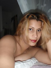 Chubby Latina on all fours in sexy darksome lingerie