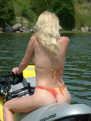 Naked blonde teen posing and spreading on skiboat