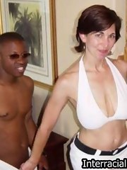 Breasty MILF expertly blows on black dick and takes it deep in her cunt