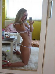 Lustful legal age teenager sexily positions in the kitchen