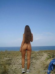 Teen posing undressed at the beach