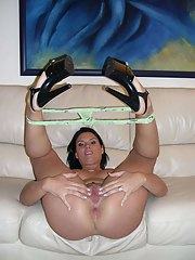 Sexy brunette MILF naked playing with her dildo in the living room