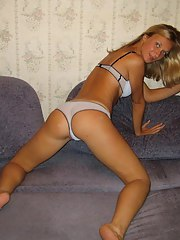Blond housewife posing around the house