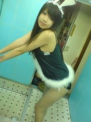 Cute youthful Asian playgirl working as a club hostess in a bunny suit
