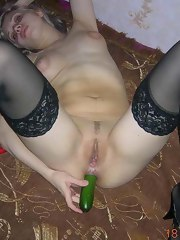 Sleazy honey fucking her holes with a cucumber